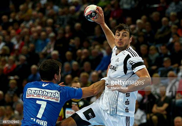 Domagoj Duvnjak of Kiel challenges for the ball with Matthias FLohr of HSV Handball during the DKB HBL Bundesliga match between THW Kiel and HSV...