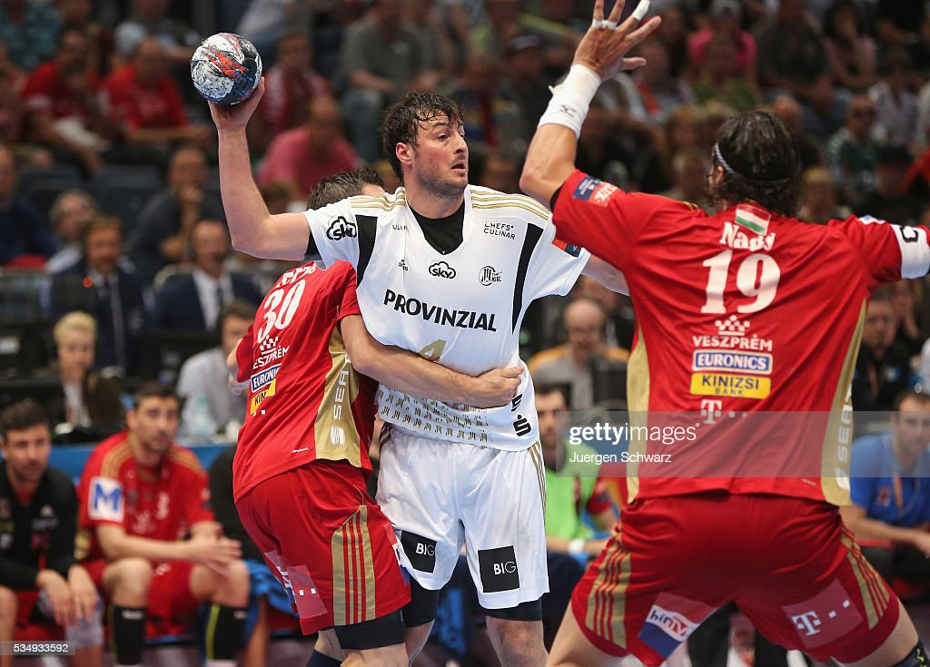 Domagoj Duvnjak of Kiel (C) is blocked by Mirsad Terzic of Veszprem (L) and Laszlo Nagy during the second semi-final of the EHF Final4 between THW Kiel and MVM Veszprem on May 28, 2016 in Cologne, Germany.