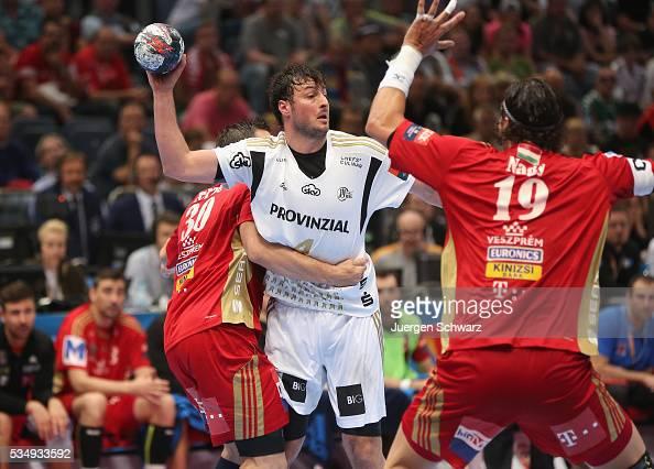 Domagoj Duvnjak of Kiel is blocked by Mirsad Terzic of Veszprem and Laszlo Nagy during the second semifinal of the EHF Final4 between THW Kiel and...