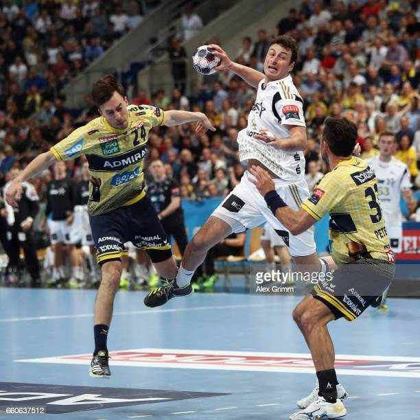 Domagoj Duvnjak of Kiel is challenged by Patrick Groetzki and Alexander Petersson of RheinNeckar Loewen during the EHF Champions League Quarter Final...