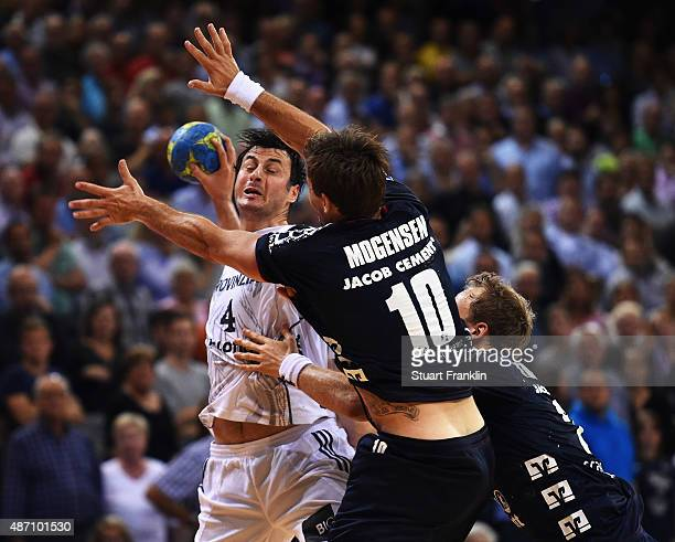 Domagoj Duvnjak of Kiel is challenged by Thomas Morgensen of Flensburg during the DKB Handball Bundeslga match between SG FlensburgHandewitt and THW...