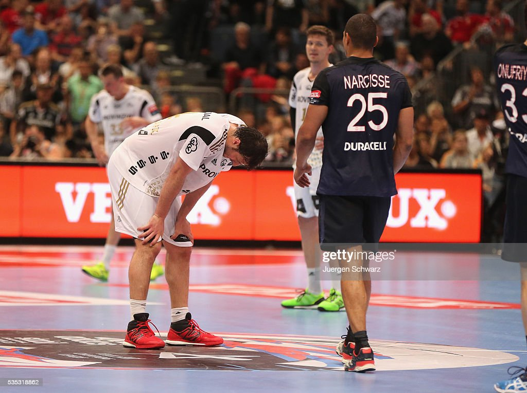 Domagoj Duvnjak of Kiel (L) looks down near Daniel Narcisse of Paris after the third place play-off at the EHF Final4 between Paris St.-Germain and THW Kiel on May 29, 2016 in Cologne, Germany.