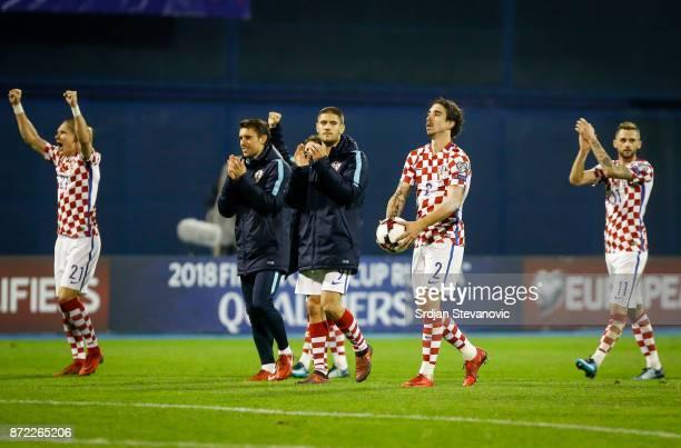Domagoj Vida Andrej Kramaric Sime Vrsaljko and Marcelo Brozovic of Croatia celebrate after winning the FIFA 2018 World Cup Qualifier PlayOff First...