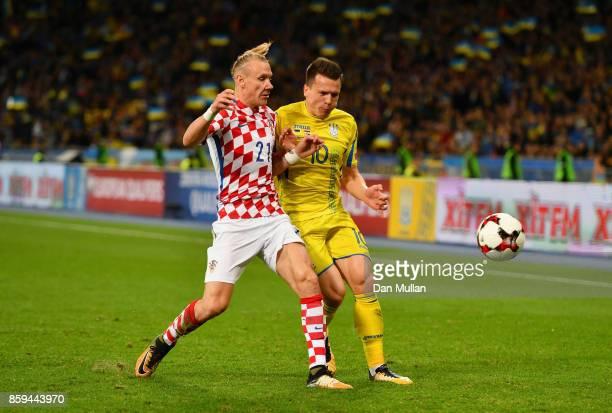 Domagoj Vida of Croatia and Yevhen Konoplyanka of Ukraine battle for possession during the FIFA 2018 World Cup Group I Qualifier between Ukraine and...