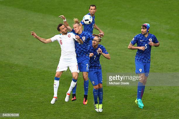 Domagoj Vida of Croatia jumps over Tomas Sivok of Czech Republic and handles the ball in box to give away a penalty during the UEFA EURO 2016 Group D...