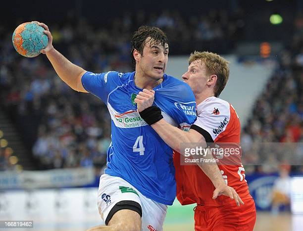 Domanagoj Duvnjak of Hamburg is challenged by Niclas Pieczkowski of Essen during the DKB Bundesliga handball game between HSV Hamburg and TUSEM Essen...