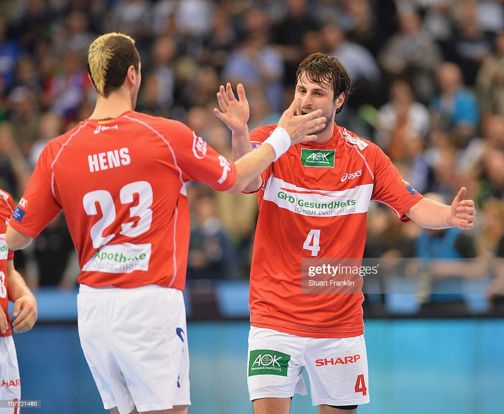 Domango Duvnjak of Hamburg celebrates with <a gi-track='captionPersonalityLinkClicked' href=/galleries/search?phrase=Pascal+Hens&family=editorial&specificpeople=577208 ng-click='$event.stopPropagation()'>Pascal Hens</a> during the Velux EHF Champions League quarter final second leg match between HSV Handball and SG Flensburg-Handewitt at O2 World on April 28, 2013 in Hamburg, Germany.