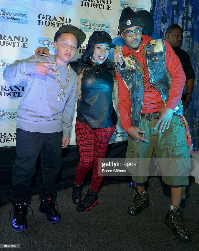 Domani Harris, Tameka 'Tiny' Harris and T.I. attend Domani Harris's birthday celebration at Indigo on March 16, 2013 in Toronto, Canada.