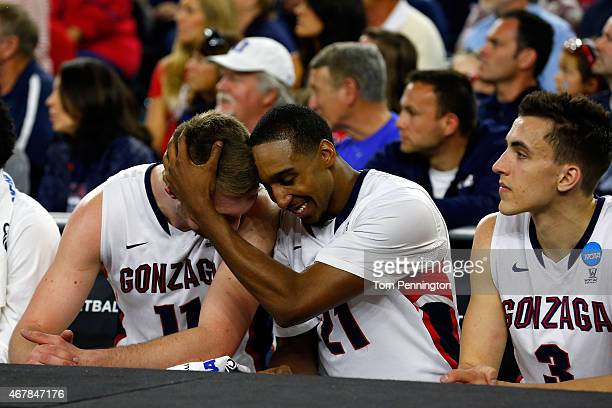 Domantas Sabonis and Eric McClellan of the Gonzaga Bulldogs celebrate on the bench against the UCLA Bruins during a South Regional Semifinal game of...