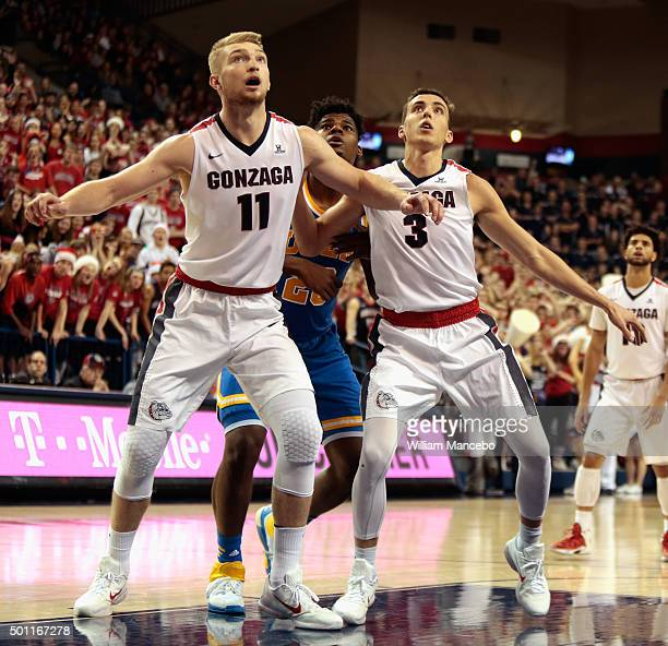 Domantas Sabonis and Kyle Dranginis of the Gonzaga Bulldogs box out Tony Parker of the UCLA Bruins after a free throw in the second half of the game...