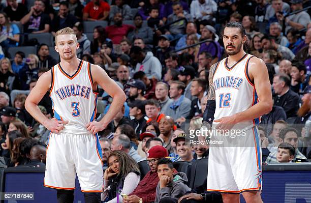 Domantas Sabonis and Steven Adams of the Oklahoma City Thunder look on during the game against the Sacramento Kings on November 23 2016 at Golden 1...