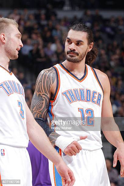 Domantas Sabonis and Steven Adams of the Oklahoma City Thunder talk during the game against the Sacramento Kings on November 23 2016 at Golden 1...
