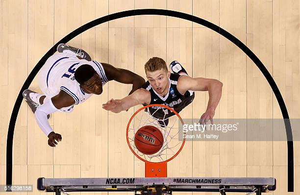 Domantas Sabonis of the Gonzaga Bulldogs and Angel Delgado of the Seton Hall Pirates look for a rebound during the first round of the 2016 NCAA Men's...