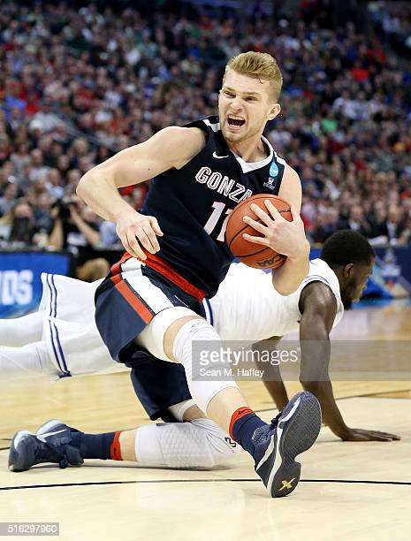 Domantas Sabonis of the Gonzaga Bulldogs and Ismael Sanogo of the Seton Hall Pirates collide in the second half during the first round of the 2016...
