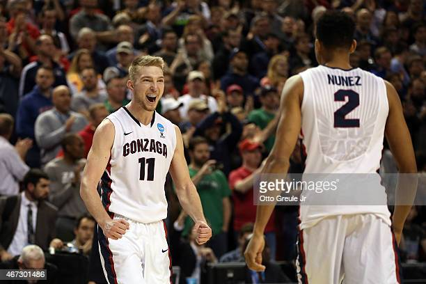 Domantas Sabonis of the Gonzaga Bulldogs celebrates with teammate Angel Nunez against the Iowa Hawkeyes in the second half of the game during the...