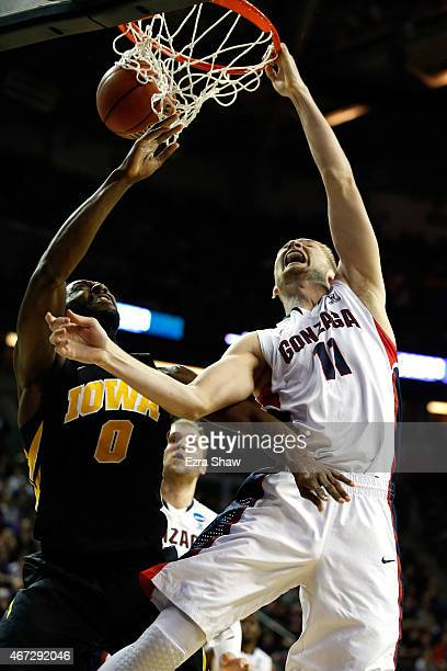Domantas Sabonis of the Gonzaga Bulldogs dunks the ball against Gabriel Olaseni of the Iowa Hawkeyes in the first half of the game during the third...