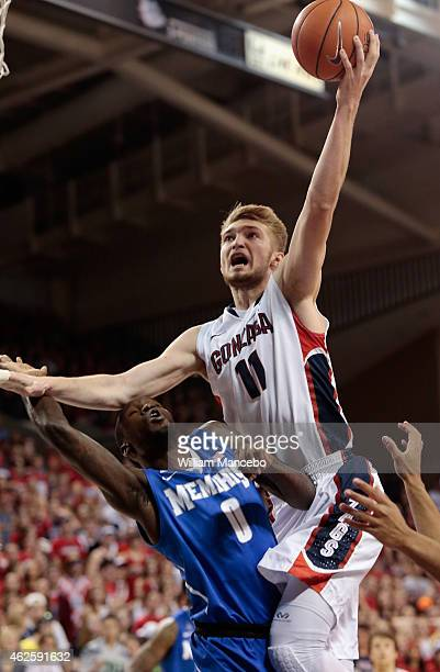 Domantas Sabonis of the Gonzaga Bulldogs goes to the basket over Trahson Burrell of the Memphis Tigers in the first half at McCarthey Athletic Center...