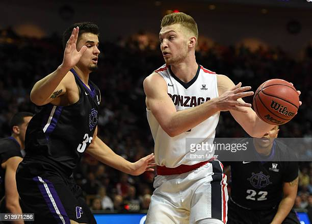 Domantas Sabonis of the Gonzaga Bulldogs is guarded by Ray Barreno of the Portland Pilots during a quarterfinal game of the West Coast Conference...