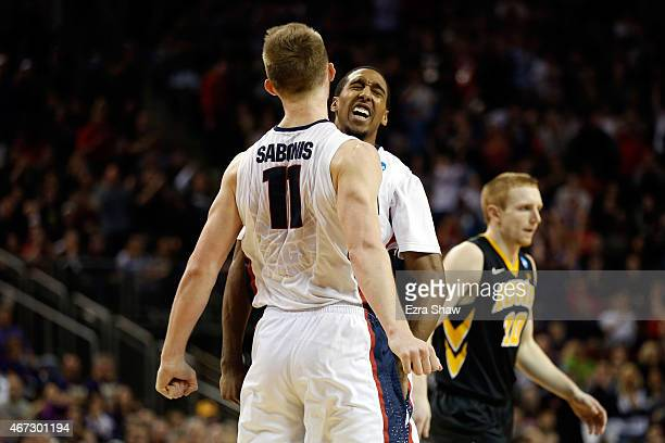 Domantas Sabonis of the Gonzaga Bulldogs reacts with teammate Eric McClellan after a three pointer in the second half of the game against the Iowa...