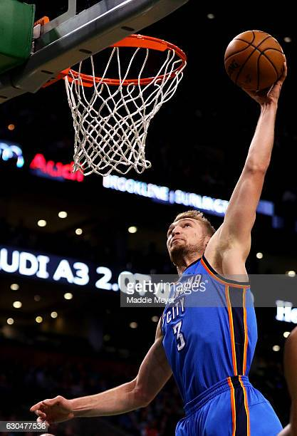 Domantas Sabonis of the Oklahoma City Thunder dunks against the Boston Celtics during the first quarter at TD Garden on December 23 2016 in Boston...