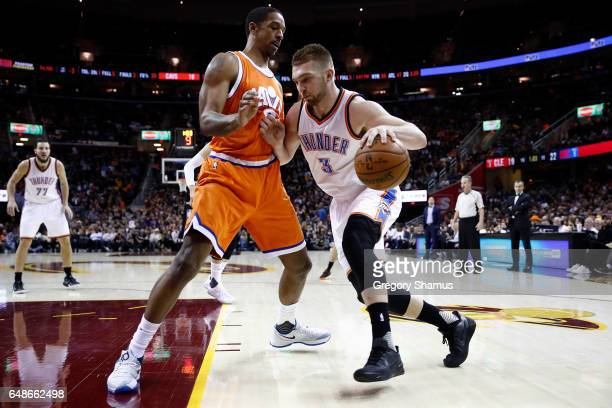 Domantas Sabonis of the Oklahoma City Thunder tries to get around Channing Frye of the Cleveland Cavaliers during the first half at Quicken Loans...