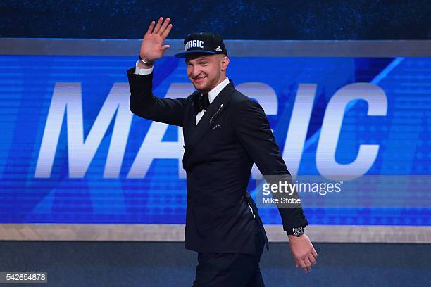 Domantas Sabonis waves on stage after being drafted 11th overall by the Orlando Magic in the first round of the 2016 NBA Draft at the Barclays Center...