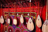 Dombra string instruments on the wall of Kazakh yurt at Nauryz celebration in Almaty, Kazakhstan