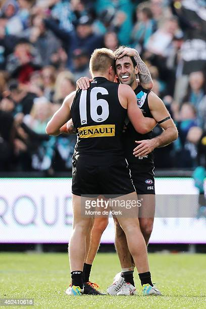 Domenic Cassisi of the Power celebrates after the round 18 AFL match between the Port Adelaide Power and the Melbourne Demons at Adelaide Oval on...