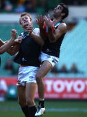 Domenic Cassisi of the Power marks over teammate Dean Brogan during the round 11 AFL match between the Hawthorn Hawks and the Port Adelaide Power at...