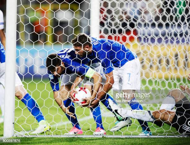 Domenico Berardi and Federico Bernardeschi of Italy takes the ball out of the net since Gianluigi Donnarumma of Italy has scores the opening goal to...