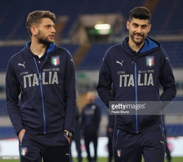 Domenico Berardi and Marco Benassi of Italy looks on before the international friendly match between Italy U21 and Spain U21 at Olimpico Stadium on...