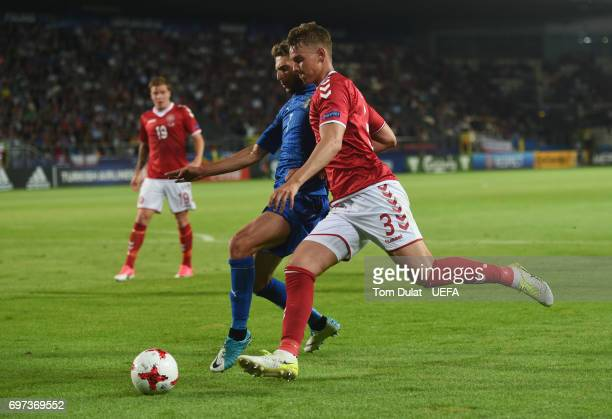 Domenico Berardi of Italy and Andreas Maxso of Denmark battle for possession during the UEFA European Under21 Championship Group C match between...
