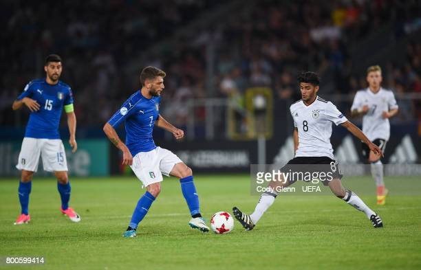 Domenico Berardi of Italy and Mahmoud Dahoud of Germany during their UEFA European Under21 Championship 2017 match on June 24 2017 in Krakow Poland