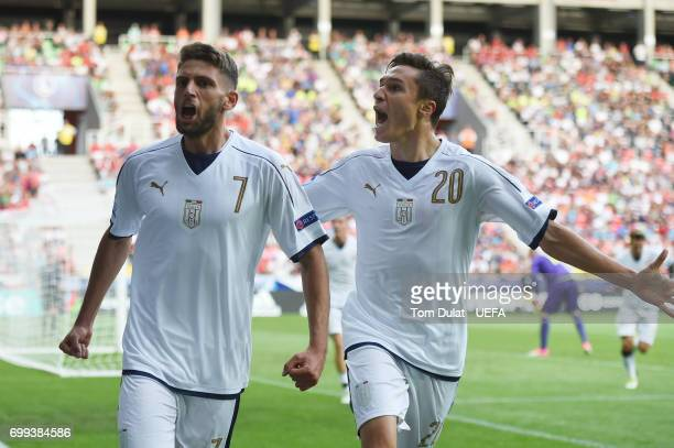 Domenico Berardi of Italy celebrates scoring his sides first goal with Federico Chiesa of Italy during the UEFA European Under21 Championship Group C...