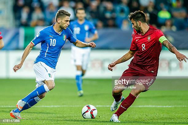 Domenico Berardi of Italy competes for the ball with Sergio Oliveira of Portugal during the UEFA Under21 European Championship 2015 match between...