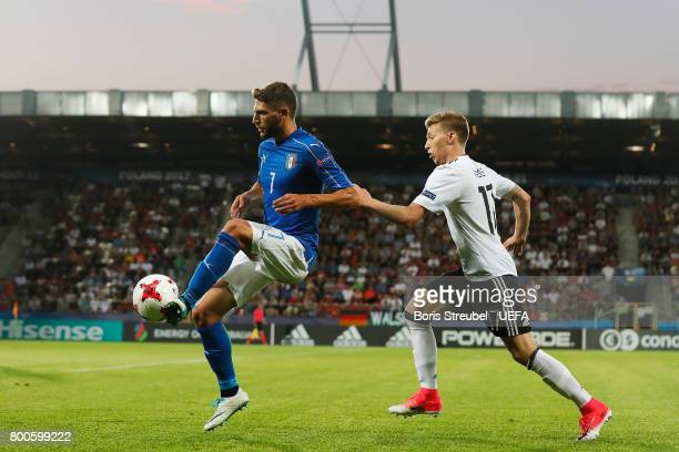 Domenico Berardi of Italy holds off Mitchell Weiser of Germany during the 2017 UEFA European Under21 Championship Group C match between Italy and...