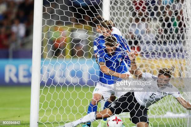Domenico Berardi of Italy pushes Niklas Stark of Germany during the UEFA U21 championship match between Italy and Germany at Krakow Stadium on June...