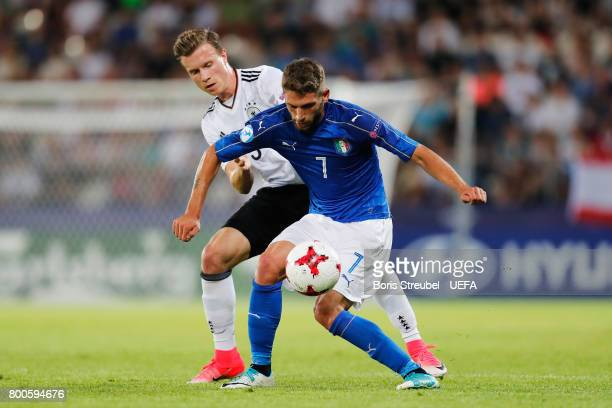 Domenico Berardi of Italy shields the ball from Yannick Gerhardt of Germany during the 2017 UEFA European Under21 Championship Group C match between...