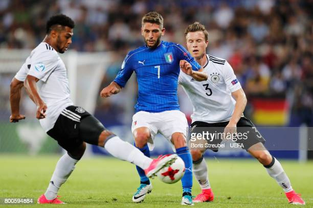 Domenico Berardi of Italy takes on Yannick Gerhardt and Serge Gnabry of Germany during the 2017 UEFA European Under21 Championship Group C match...