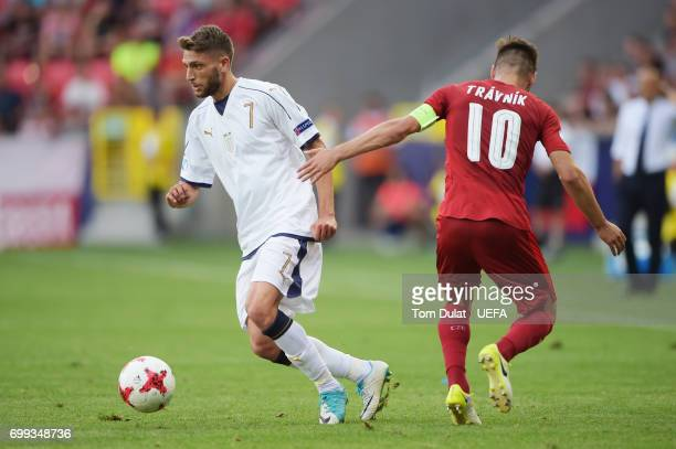 Domenico Berardi of Italy takes the ball past Michal Travnik of Czech Republic during the UEFA European Under21 Championship Group C match between...