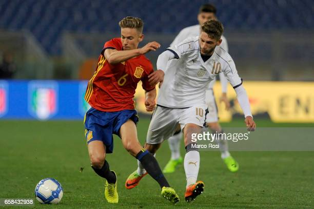 Domenico Berardi of Italy U21 ompete for the ball with Marco Llorente during the international friendly match between Italy U21 and Spain U21 at...