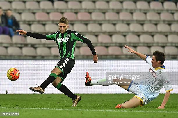 Domenico Berardi of Sassuolo and Luca Paganini of Frosinone in action during the Serie A match between US Sassuolo Calcio and Frosinone Calcio at...