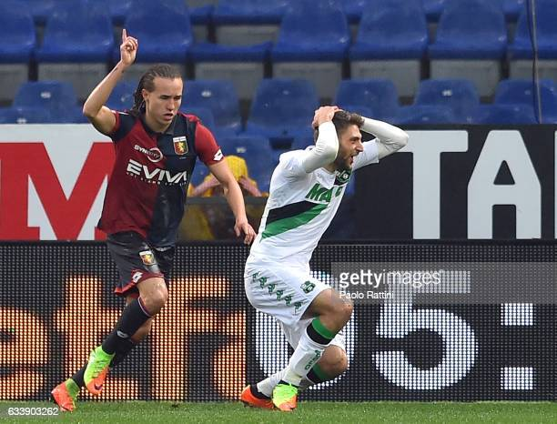 Domenico Berardi of Sassuolo asks for a penalty kick after being tackled by Diego Sebastian Laxalt of Genoa during the Serie A match between Genoa...