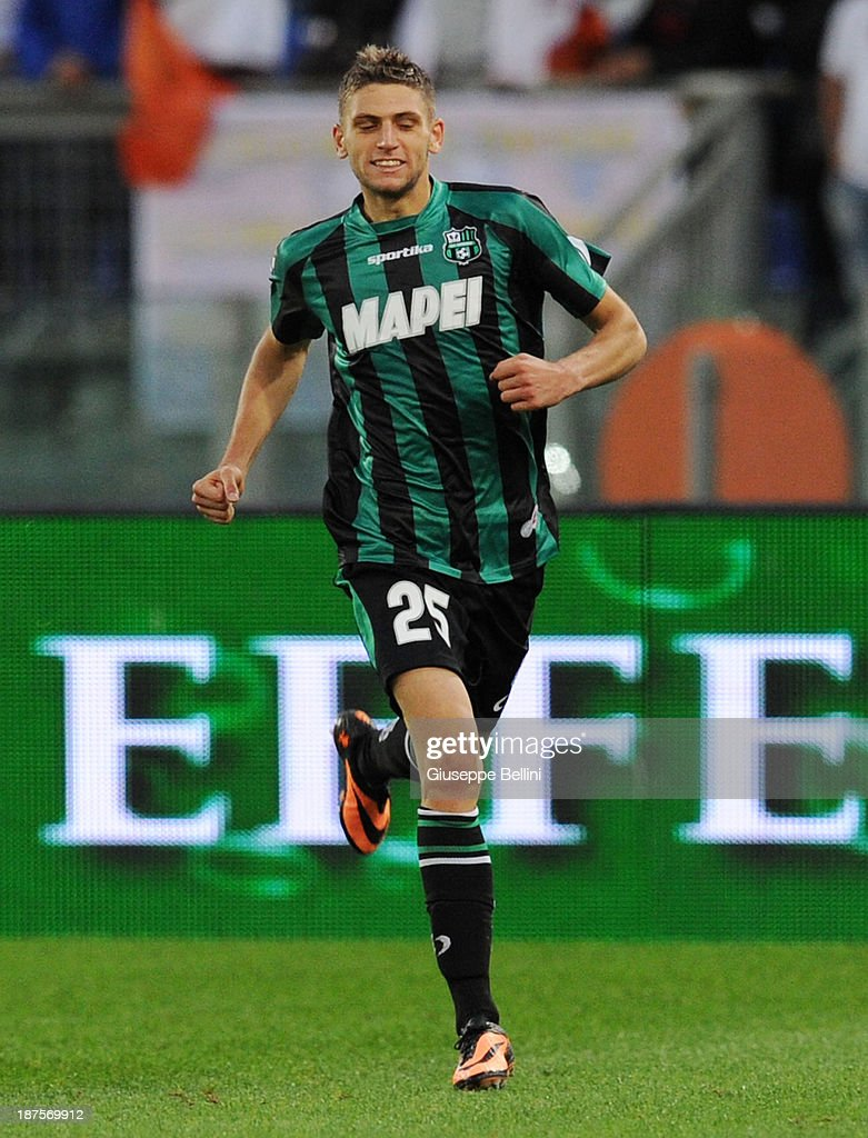 Domenico Berardi of Sassuolo celebrates after scoring the goal 1-1 during the Serie A match between AS Roma and US Sassuolo Calcio at Stadio Olimpico on November 10, 2013 in Rome, Italy.