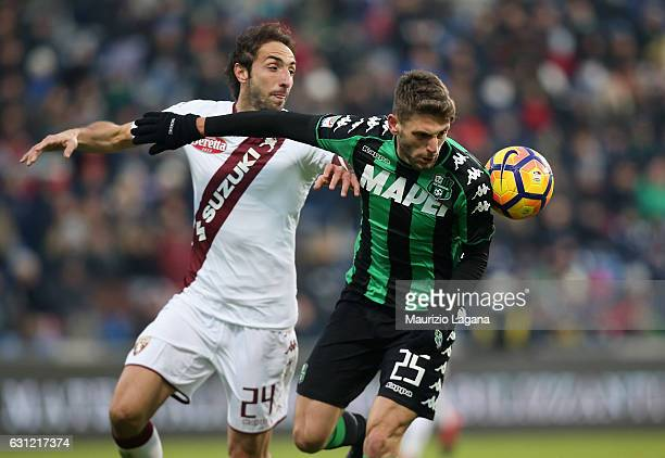 Domenico Berardi of Sassuolo competes for the ball with Emiliano Moretti of Torino during the Serie A match between US Sassuolo and FC Torino at...