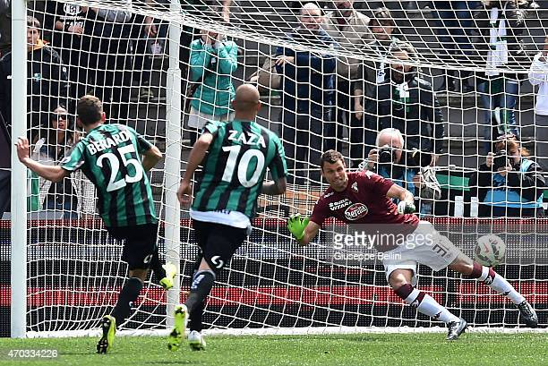 Domenico Berardi of Sassuolo kicks the penalty and scores the opening goal during the Serie A match between US Sassuolo Calcio and Torino FC at Mapei...