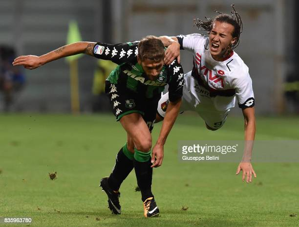 Domenico Berardi of US Sassuolo and Diego Laxalt of Genoa CFC in action during the Serie A match between US Sassuolo and Genoa CFC at Mapei Stadium...