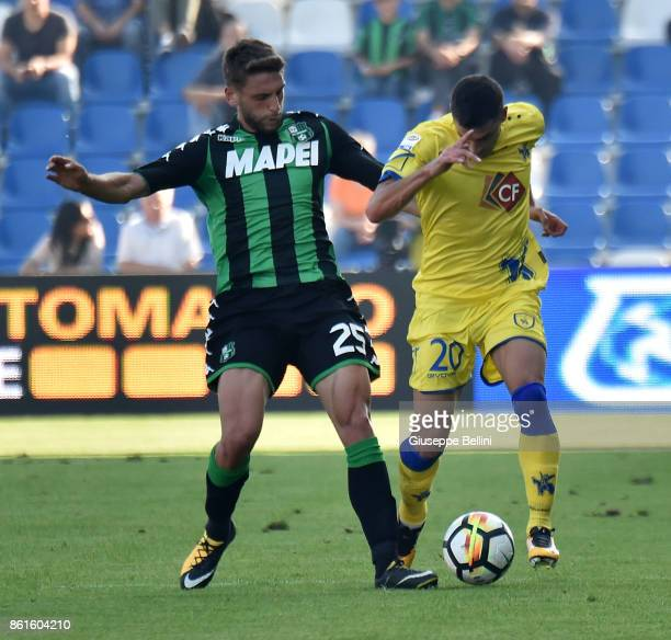 Domenico Berardi of US Sassuolo and Manuel Pucciarelli of AC Chievo Verona in action during the Serie A match between US Sassuolo and AC Chievo...