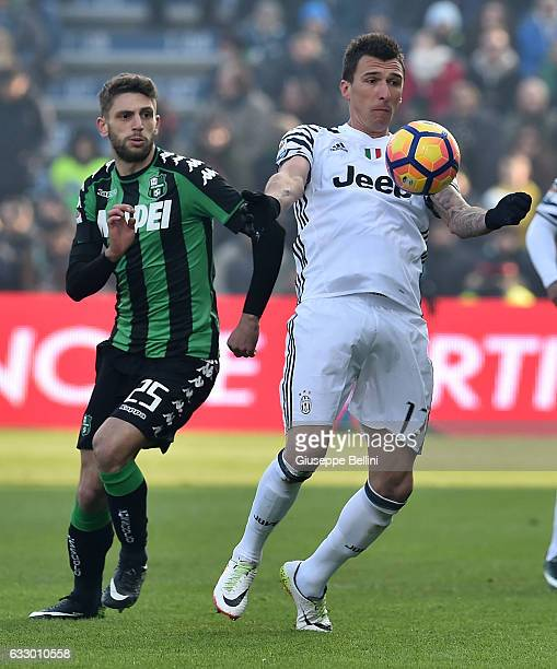 Domenico Berardi of US Sassuolo and Mario Mandzukic of Juventus FC in action during the Serie A match between US Sassuolo and Juventus FC at Mapei...