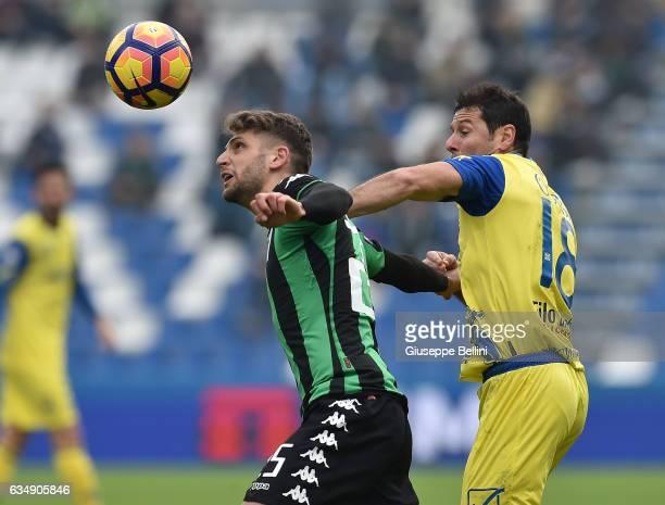 Domenico Berardi of US Sassuolo and Massimo Gobbi of AC Chievo Verona in action during the Serie A match between US Sassuolo and AC Chievo Verona at...
